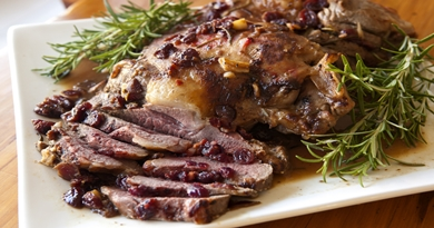 Lamb roasted with rosemary, cranberries and garlic.