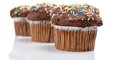 A three tasty muffin with chocolate, isolated on white background. Shallow DOF
